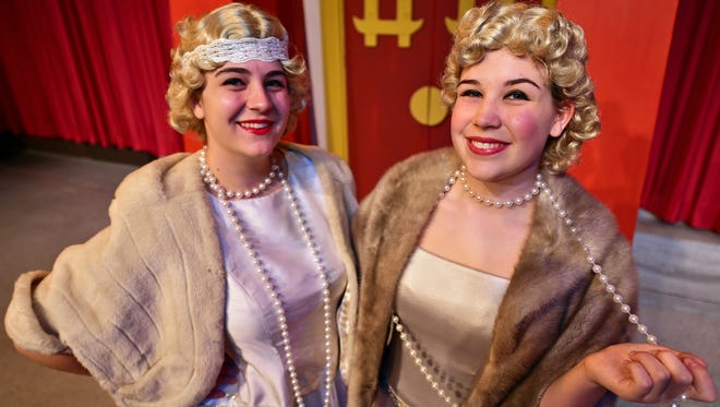 """Sisters Madeleine, left, and Claire Porter are both playing the part of Lina Lamont in the upcoming production of """"Singin' in the Rain Jr."""" at New Stage Theatre in Jackson."""