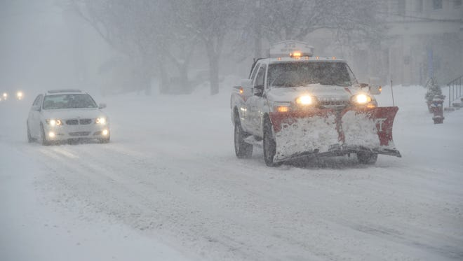 A snowplow travels down Mill Street in the City of Poughkeepsie.