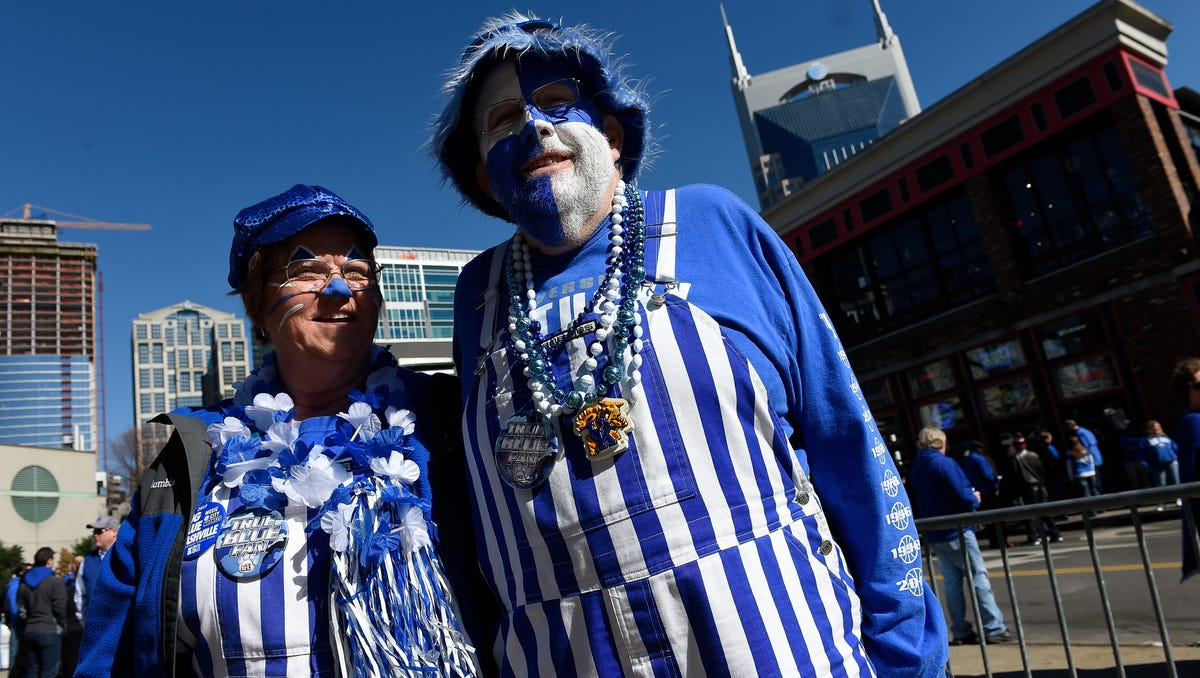 Kentucky fans Denise and George Camic of Harrodsburg, Ky get ready to watch the Wildcats take on Arkansas in the SEC Men's Basketball Championship at Bridgestone Arena Sunday, March 12, 2017 in Nashville, Tenn.