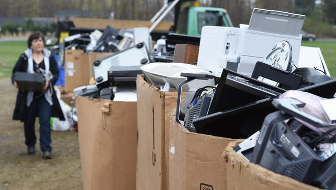 A view of the piles of electronics to be recycled at an Earth Day event at the Hyde Park Drive-In on Route 9 in Hyde Park.