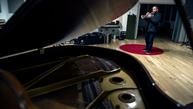 Matt Cappy of Collingswood plays his trumpet inside the Gradwell House recording studio in Haddon Heights.