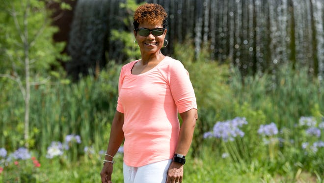 """Marshelle Moreland, 56, of Tallahassee, seen May 31, 2018 at Cascades Park in the state capital, has several issues on her mind this election year, including the environment, merit-based funding, equality and diversity, health care and Amendment 4, which would restore voting rights to roughly 1.4 million felons. Moreland spent 33 years working for the U.S. Postal Service before moving to Tallahassee, where the canopy of trees and exposure to nature drew her in to becoming more """"politically astute"""" concerning the environment. """"I'm from South Florida where there's a lot of development. I understand the need for development, but I also know that it should be balanced, and this area is beautiful. I hope we don't lose that,"""" she said."""