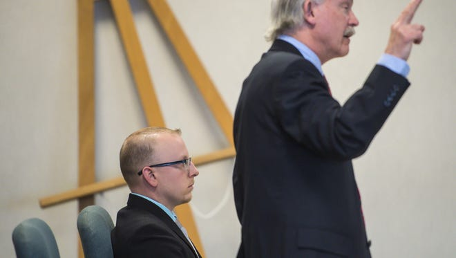 William Savaria, left, a former corrections officer at the Chittenden Regional Correctional Facility in South Burlington, listens as his lawyer E.M. Allen speaks in Vermont Superior Court in Burlington on Wednesday, March 16, 2016.  Savaria was acquitted of sexual exploitation of a confined inmate.