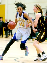 Sidney Cooks, left, is averaging 22.9 points and 12.5
