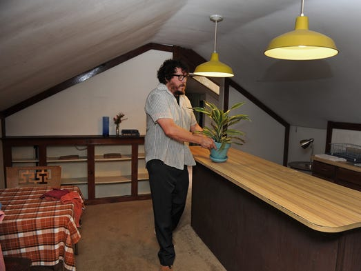 Bobby Bare Jr. spruces up a room at his home for guests that will be staying in his AirBNB in East Nashville. AirBNB, a Lyft-like service for short-term lodging, is growing fast in Nashville. In fact, it's the fastest growing city in the country for the company. But it's also gaining the attention of regulators, who say that people aren't paying their fair share of lodging taxes.