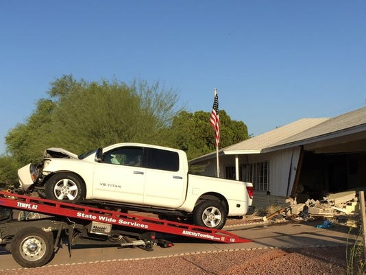 635652942217340216-Scottsdale-car-into-house