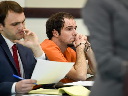 Chris D. McLawhorn, right,  sits next to his defense