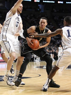 Jan 17, 2015; University Park, PA, USA; Purdue Boilermakers guard Kendall Stephens (21) fights to maintain possession of the ball during the second half against the Penn State Nittany Lions at Bryce Jordan Center. Purdue defeated Penn State 84-77 in overtime. Mandatory Credit: Matthew O'Haren-USA TODAY Sports