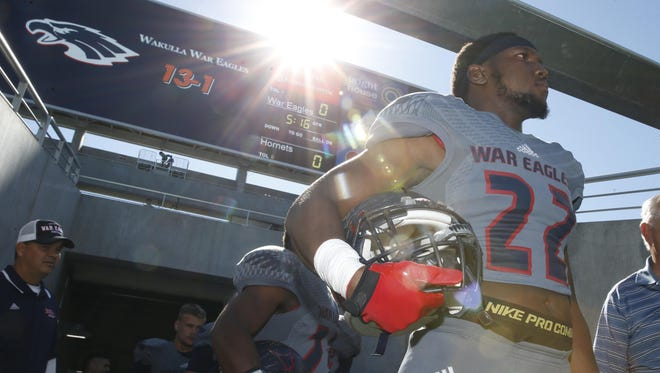 Wakulla's Monterious Loggins waits to charge on to the field at the Citrus Bowl to take on Bishop Moore during their Class 5A State Title game in Orlando Friday.
