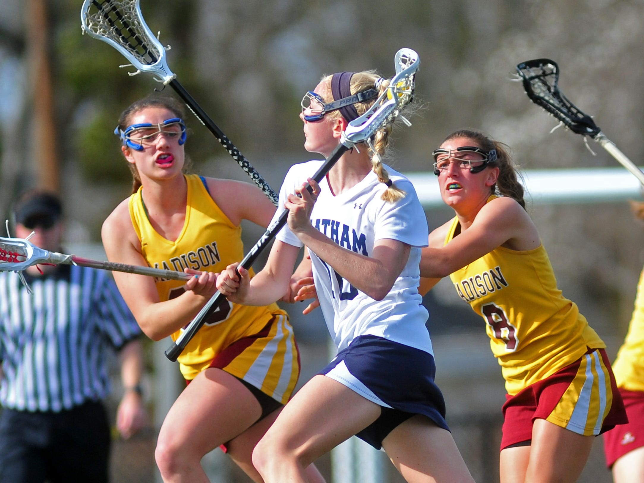Madison's Catherine Crowley (left) and Molly Fisher flank Chatham's Bridget Ballard as she heads to the goal.
