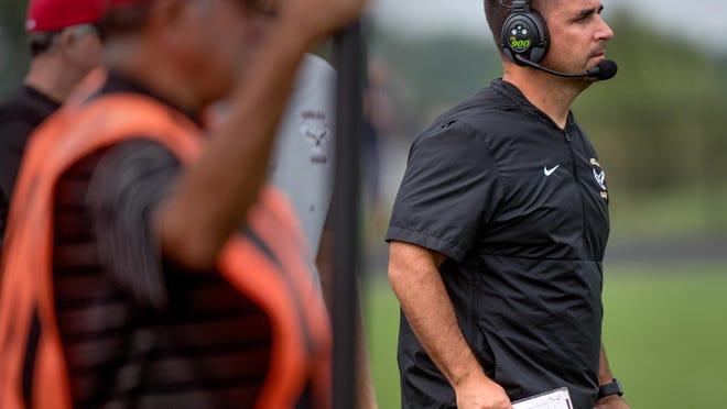 Dunlap head coach Brett Cazalet ponders his next move as the Eagles take on the Metamora Redbirds on Saturday, Sept. 28, 2019 in Metamora.