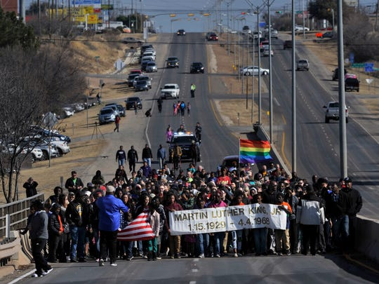 Marchers celebrate the life of civil rights icon Martin Luther King, Jr. during the annual march Monday Jan. 15, 2018 over the bridge bearing his name east of downtown Abilene. At least 200 adults, children and others of diverse backgrounds and color crossed the bridge going west, then turned and crossed again to return to their starting point at the corner of E. Highway 80 and Cockerell Dr.