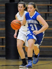 Memorial's Soffia Rieckers dribbles the ball down the court in a game against Boonville last season.