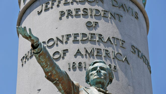 This Wednesday, June 28, 2017, shows statue of Confederate president Jefferson Davis on Monument Avenue in Richmond, Va. As cities across the United States are removing Confederate statues and other symbols, dispensing with what some see as offensive artifacts of a shameful past marked by racism and slavery, Richmond is taking a go-slow approach.
