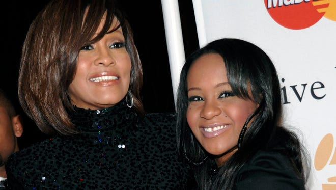 The mother-daughter duo is seen together in 2011, almost exactly a year before Houston's death.