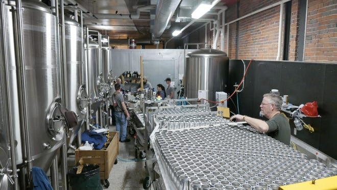 The Montana Canning Co. of Livingston cans beer recently at the Mighty Mo Brewing Co.