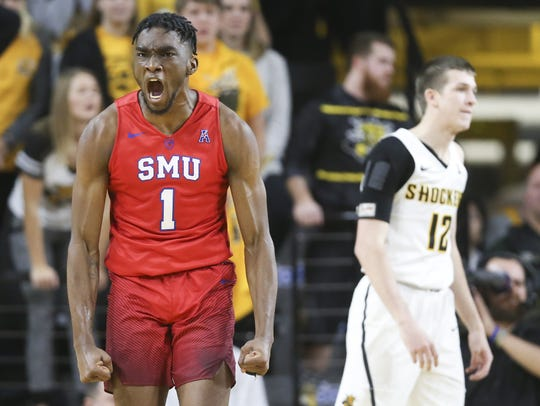 Southern Methodist's Shake Milton celebrates a basket