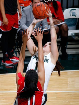Michigan State's Tori Jankoska shoots a layup against Louisville's Arica Carter (11) Thursday, Dec. 3, 2015, in East Lansing, Mich. Michigan State fell 85-78.