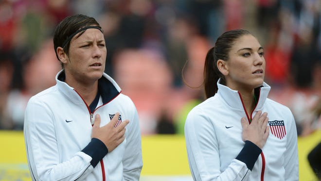 A 2013 file photo of Abby Wambach, left, and Hope Solo  before the match against New Zealand.