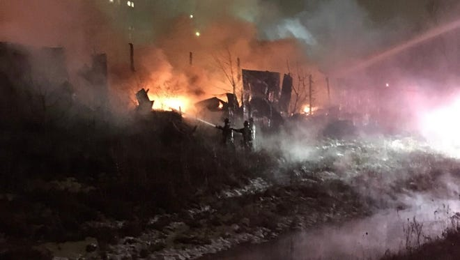 Indianapolis firefighters battle a two-alarm fire in the 4000 block of Bethel Avenue.