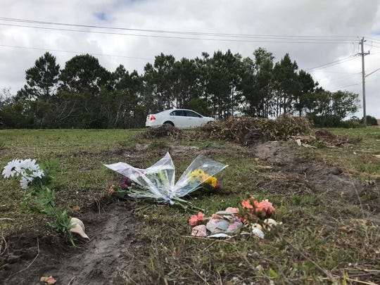 Flowers and shells are seen Thursday, May 3, 2018, at the site of a crash on Southeast Berkshire Boulevard, Port St. Lucie, in which a 20-year-old died Tuesday.