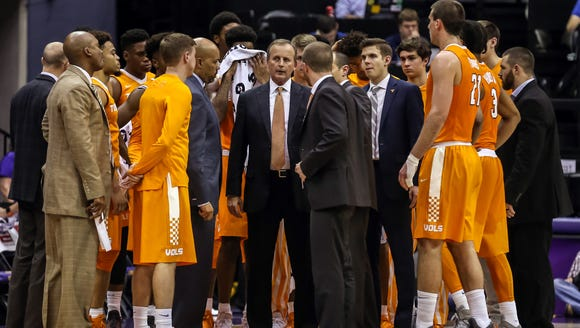 Tennessee head coach Rick Barnes (middle) looks on