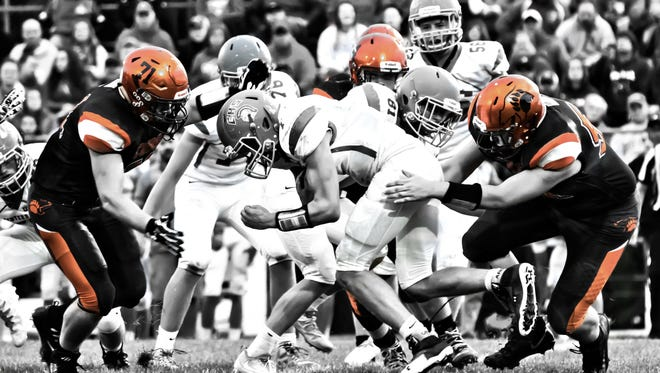 In addition to the magic he makes with his video camera, Jarred Bates also gets creative with still photography. This mix of black and white with color is from a game against Centerburg.