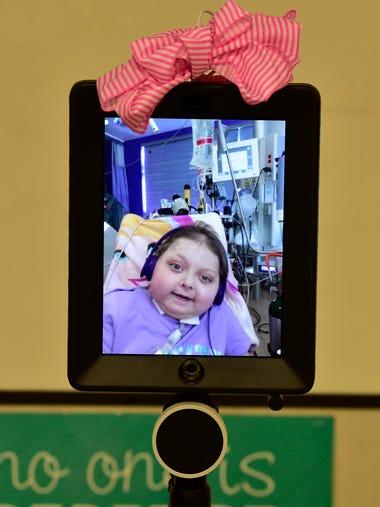 Reese Burdette uses her robot to visit  Mercersburg