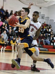 Delaware Valley's Kevin Scanian (20) gets past Bound Brook's Tyson Amaker on Tuesday at Bound Brook.