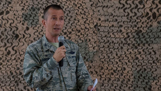 Colonel Houston Cantwell, the 49th Wing commander, addresses Holloman Airmen during his first commander's call at Holloman Air Force Base on Sept. 29. Cantwell discussed various topics with the Airmen from his first impressions to the importance of the RPA mission.