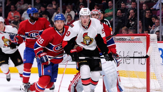 Josh Gorges of the Montreal Canadiens defends against David Dziurzynski of the Ottawa Senators during an NHL preseason game at the Bell Centre in 2013.