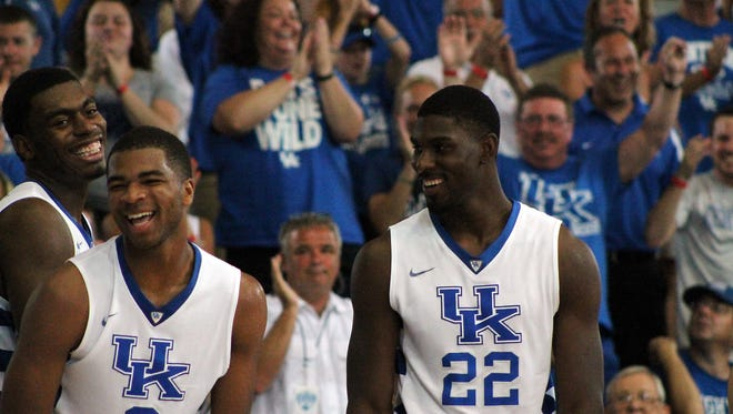 University of Kentucky's Dakari Johnson, Aaron Harrison and Alex Poythress celebrate on the bench during the team's exhibition game against the Dominican Republic national team in Nassau, Bahamas. August 15, 2014.