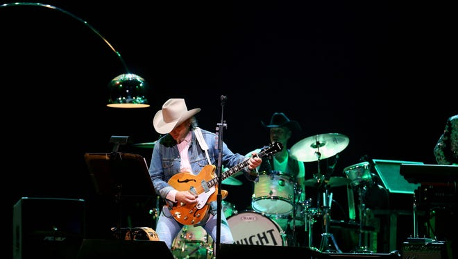 Dwight Yoakam entertains the crowd at the KFC Yum! Center on Thursday night.   Photo by Scott Utterback/The Courier-Journal Sept. 25, 2014