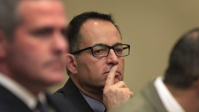 LDC defendant John Maggio, center, listens during a LDC hearing on Jan. 31, 2014.