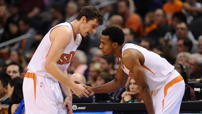 Goran Dragic, left, Ish Smith and the SUns handed the Blazers their first loss since Nov. 5.