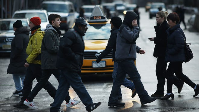 Pedestrians cross a street on Broadway at one of the deadliest intersections in Manhattan. New York is getting a federal grant of more than $800,000 to address pedestrian safety.