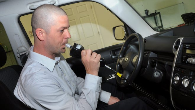 Peter Andrews, director of operations with Monitech Ignition Interlock Systems, demonstrates how to use the ignition interlock system at the company's headquarters in Wilmington, N.C.
