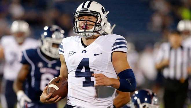 Taysom Hill runs the ball for a touchdown against Connecticut at Rentschler Field. Brigham Young defeated UConn 35-10.
