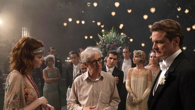 """This image released by Sony Pictures Classics shows director Woody Allen, center, with actors Emma Stone, left, and Colin Firth on the set of """"Magic in the Moonlight."""""""