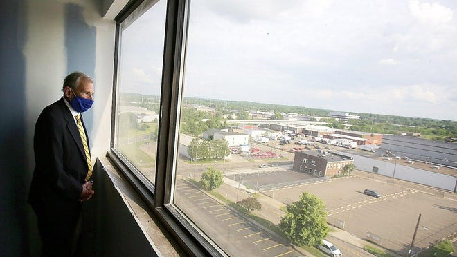 Canton Mayor Thomas  Bernabei looks at the view from one of the rooms being re-done at what will be the Hall of Fame Village Doubletree Canton, formerly the McKinley Grand