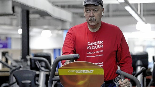 Tom Levenick, a former Ohio State University football player and current captain of the Varsity O Peloton team, works out on an elliptical machine July 29 at the YMCA in Grove City. Levenick was diagnosed with brain cancer in 2016 and continues to undergo treatment for the disease. His Pelotonia goal is to run 500 miles on the YMCA elliptical machines and donate platelets to the American Red Cross every two weeks between Memorial Day and Labor Day.