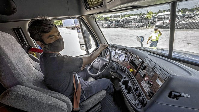 Truck-driving student Robin Gajmer, 28, of Columbus practices backing up a truck Aug. 25 at the new Roadmaster Drivers School in Columbus.