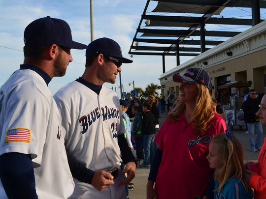 Colleen Kelly spends time with her daughters at a Blue Wahoos game.