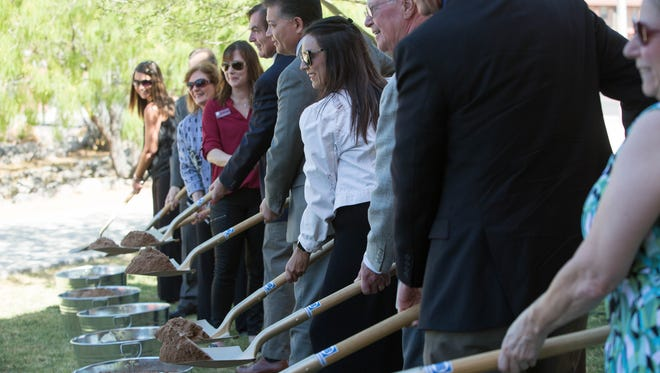 Local dignitaries shovel dirt from buckets during the ground breaking ceremony for the Las Cruces Convention Center expansion. Wednesday May 16, 2018.