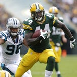 Green Bay Packers running back James Starks runs for a touchdown in the first quarter.