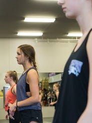 Mary Kate Statz, 16, practices a dance routine at Champion