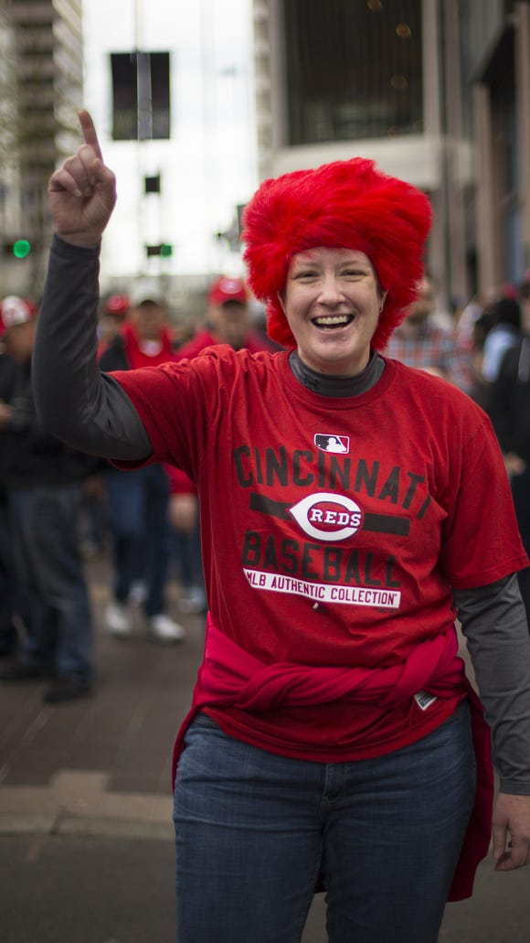Tamara Ramer, 43, of Anderson Twp. shows her Reds pride on Opening Day.