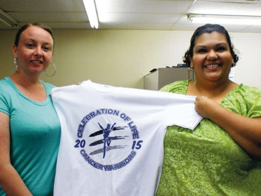 Bill Armendariz - Headlight Photo   Stevey Almanza, left, and Joanna Costilla display the 2015 Celebration of Life T-shirt for the cancer walk slated for 8 a.m., Saturday, May, 2, at Voiers' Park. Proceeds from the walk will benefit the Cancer Support Group of Deming and Luna County Inc. This is the 10th anniversary of the walk. Last year's walk generated over 76,000 that was used locally for cancer patients.