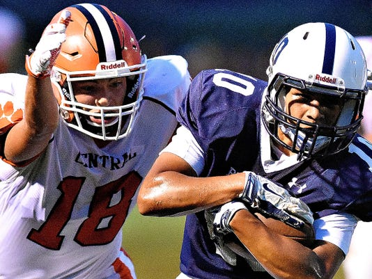 Central York's Corbin Chevaux, left, looks to take down West York's Dante Dorm on Friday. Central York won the game, 31-28, on a last-minute touchdown.