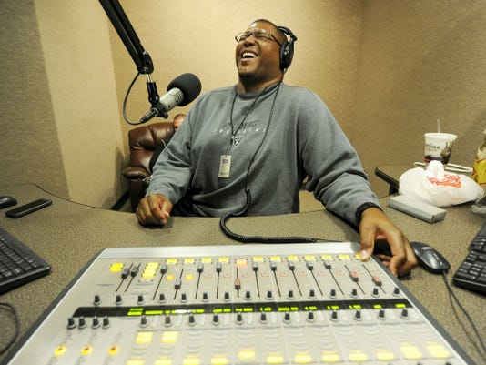 "Former York resident Lincoln Kennedy jokes around with partner Anthony Gargano, not pictured, while recording their Fox Sports Radio show from Phoenix. The former NFL lineman admits he's not a hard hammer on sports talk. ""I'm one of the few voices of reason,"" he said, smiling. ""You have so many fanatical people who get so carried away with their points   There's not a homeristic attitude about me. Even though I played for the Raiders, I'm not totally partial to the Raiders, and I think people appreciate that."""